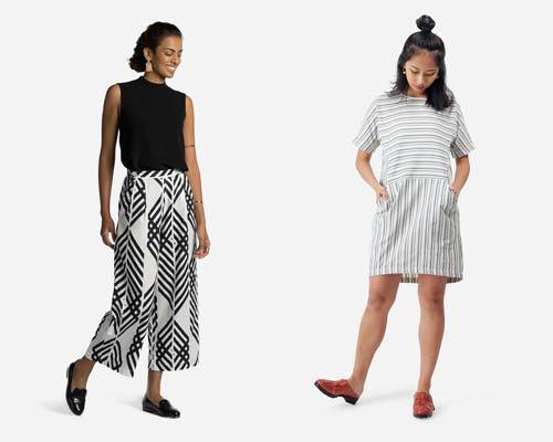 Woman wearing white and black printed wide leg cropped trousers with a black sleeveless top tucked in and black leather loafers and woman wearing white and light blue and grey striped tunic dress with red leather slip on shoes from sustainable womenswear brand Matter