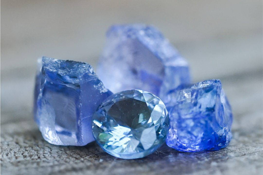 Raw and polished tanzanite from the tanzanite jewelry collection