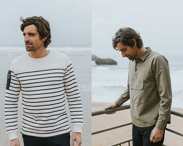 Man wearing organic cotton breton stripe long sleeve top and man wearing olive green sustainable pullover