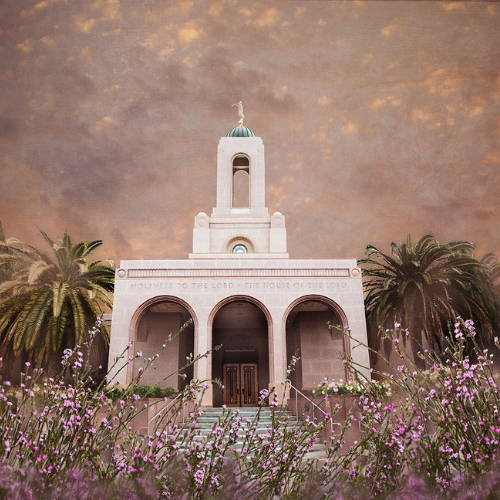 Image of the Newport Beach Temple surrounded by flowers and palm trees.