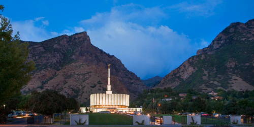 Provo Temple glowing against the night sky.