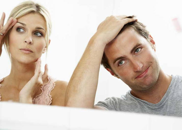 man and woman testing hair loss