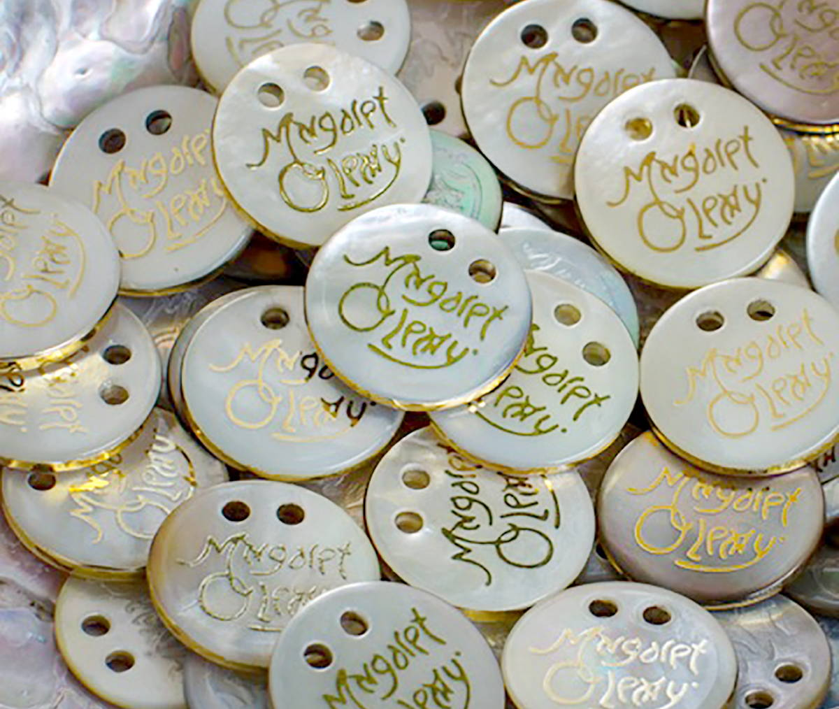 A pile of Margaret O'Leary signature pearl buttons