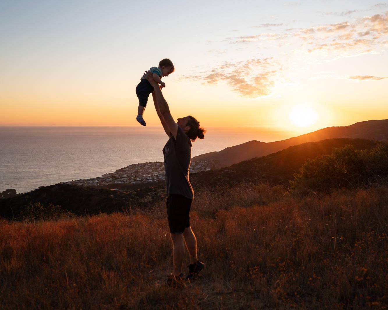 Father son sunset beach John Suhar