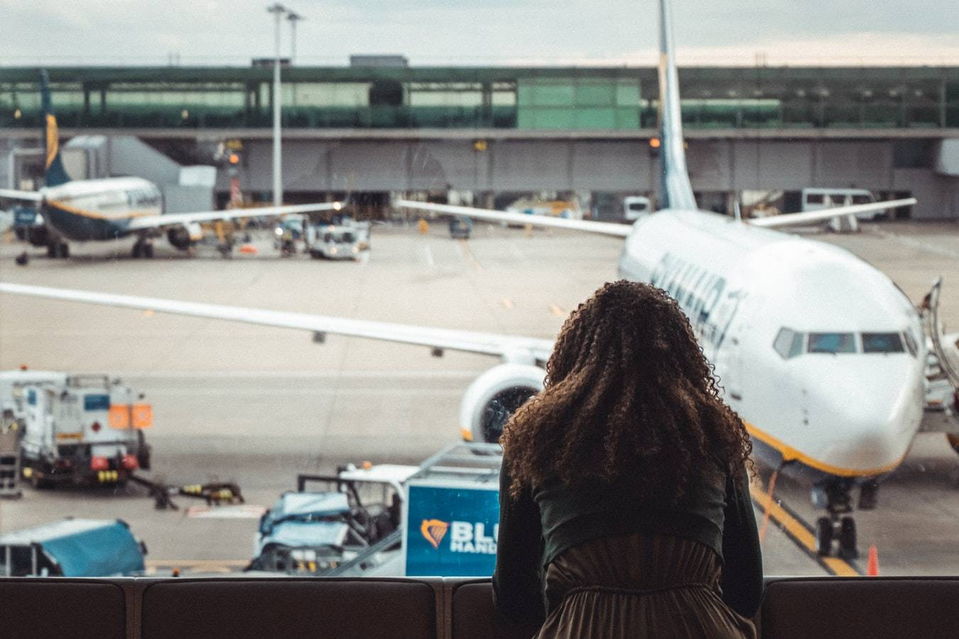 Women looking out the window in an airport