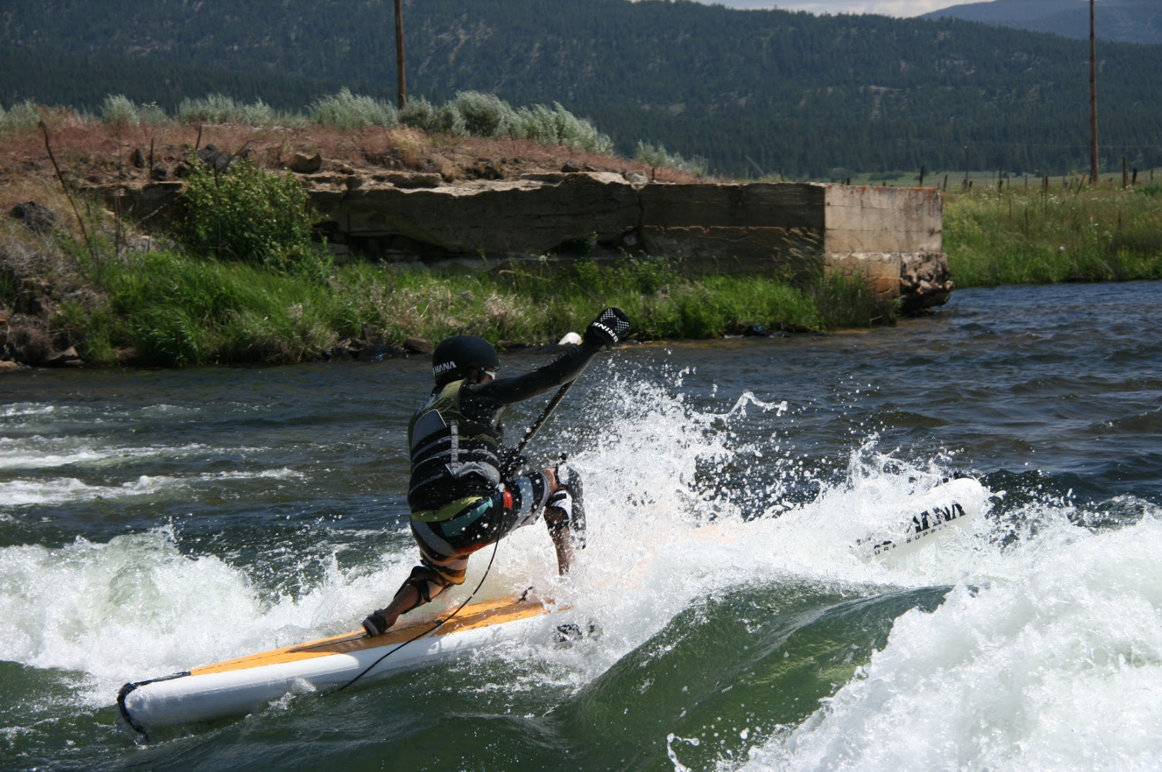 Paddling a Big Ez Hawaiian air by Pau Hana surf supply on the river in cascade idaho