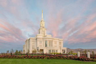 Photo of Payson LDS Temple surrounded by pink flowerbeds and green grass.