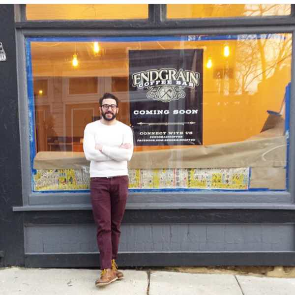 Joe in 2015 standing in front of the original 2nd Ave location