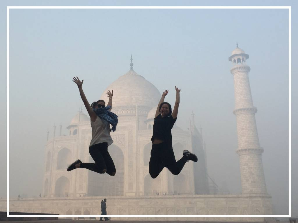 jumping in front of the taj mahal tourist photo