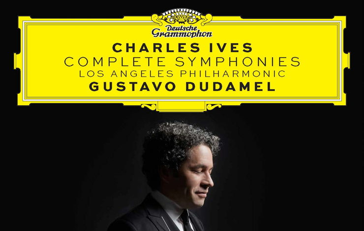 "Album cover for Ives: Complete Symphonies recording. Side profile of Gustavo Dudamel against a black background looking down, smiling, holding his baton. Above his head, ""Charles Ives, Complete Symphonies, Los Angeles Philharmonic, Gustavo Dudamel"" in a yellow Deutsche Grammophon text box."