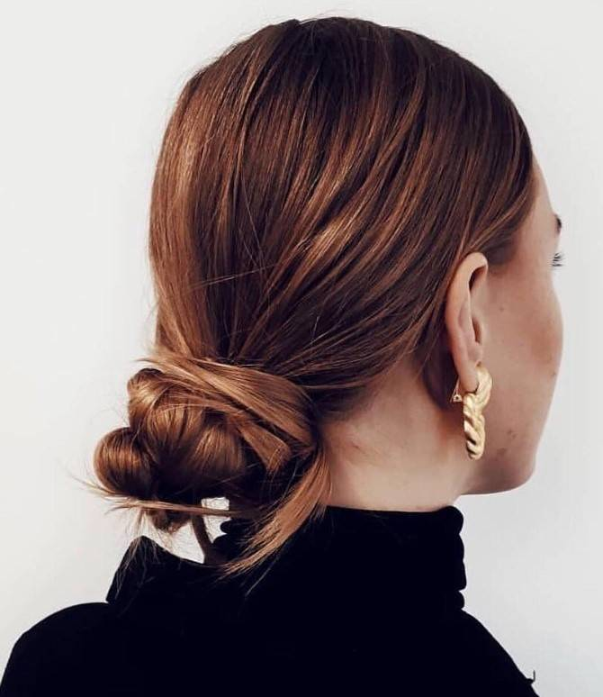 Back view of a woman with auburn hair in a bun
