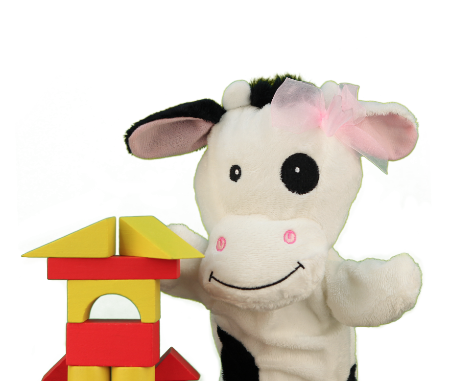 Primrose Friend Molly the cow with building blocks structure