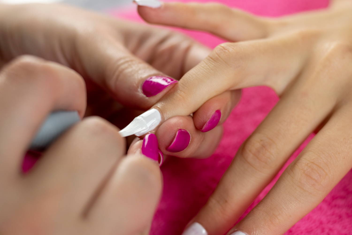 Nail being painted with ORLY White Tips nail polish