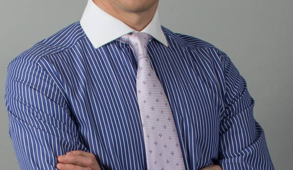 Man wearing tie with undershirt not showing