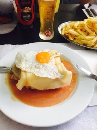 Our team picks Café Nelma in Porto as a place to try francesinha sandwich.