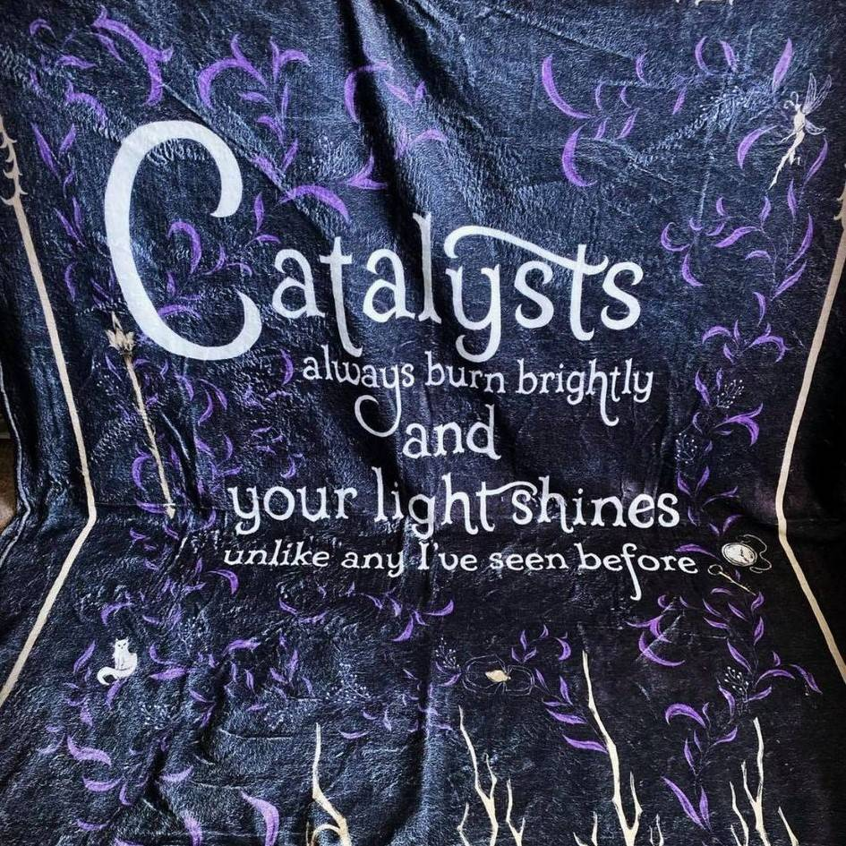 """Blanket saying, """"Catalysts always burn brightly and your light shine unline any I've seen before""""."""