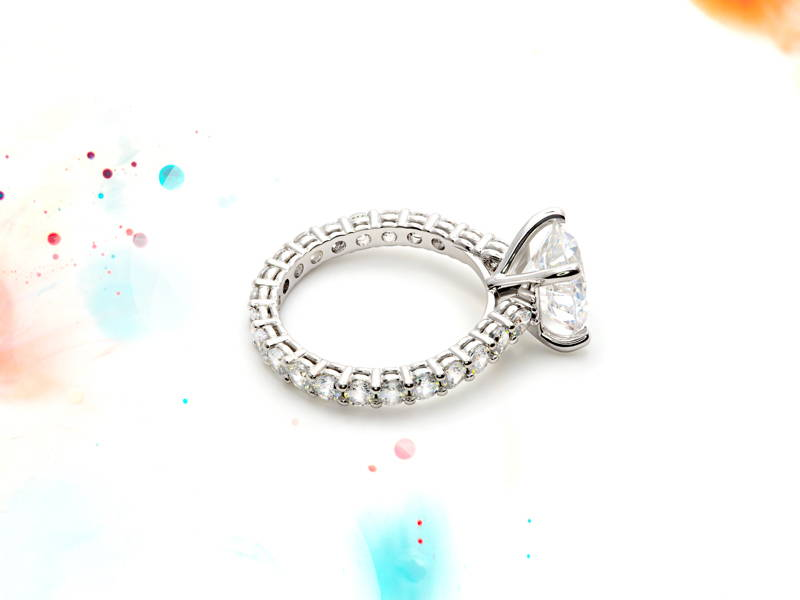 Halo ring encircled by small diamonds with a large main diamond mounted on four claws