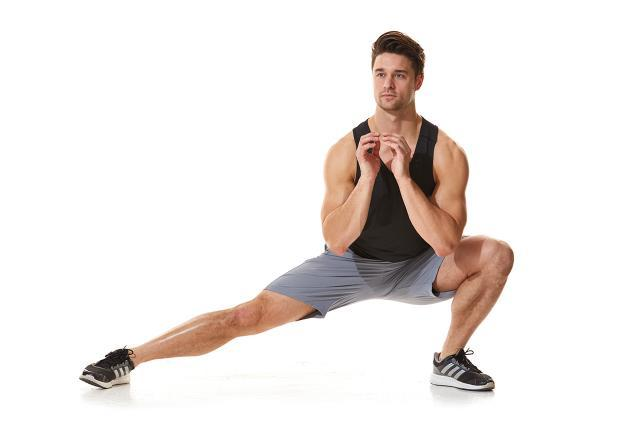 Stand tall and then take a lateral lunge.
