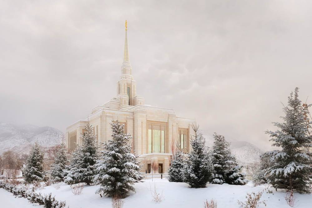 Angled photo of the Ogden Temple amid snowfall.