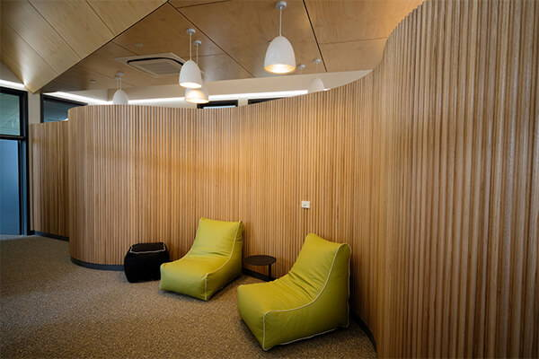 Gorgeous plywood interior panels at Hope Street Youth Refuge in Melbourne
