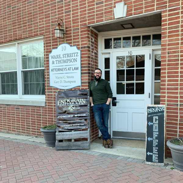 Joe Fultano, owner of Endgrain, poses in front of new storefront