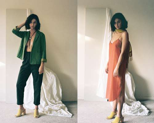 Woman wearing artisan made green deconstructed blazer with black high waisted cropped trousers and yellow slide on heeled sandals from sustainable womenswear brand Leo Strange and woman wearing red slip dress with yellow scarf and yellow heeled slip on sandals