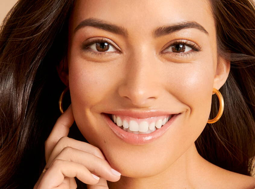 close up of women smiling with perfect eyebrows