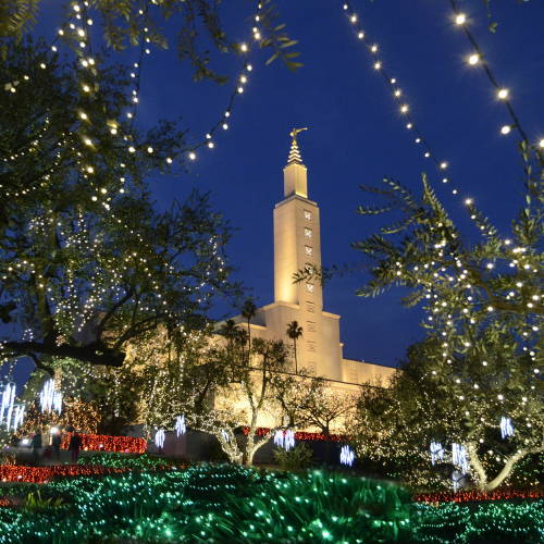 The Los Angeles Temple surrounded by strings of Christmas lights.