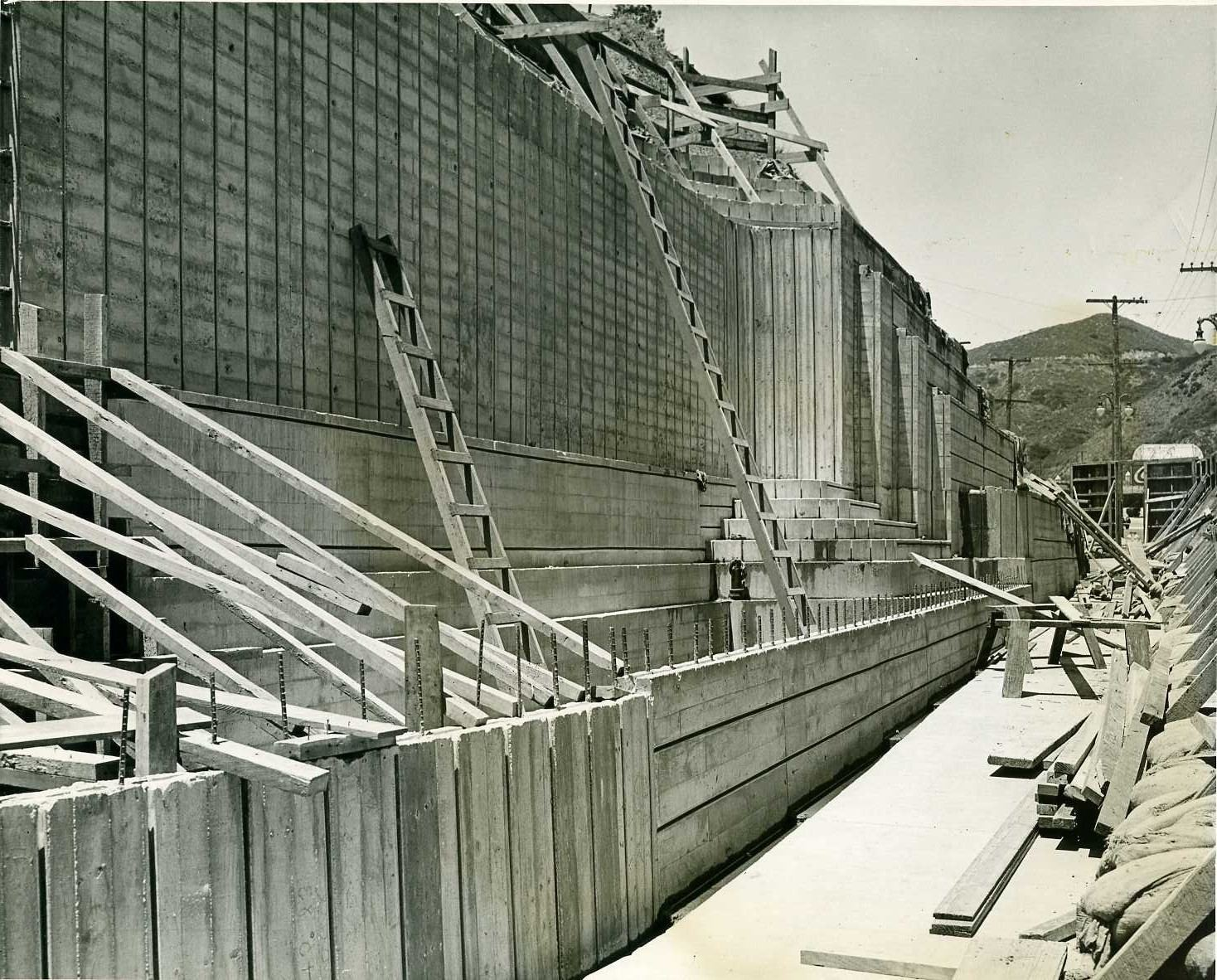Construction of George Stanley fountain looking north on Highland Avenue side of entrance to the Hollywood Bowl, May 26, 1939.
