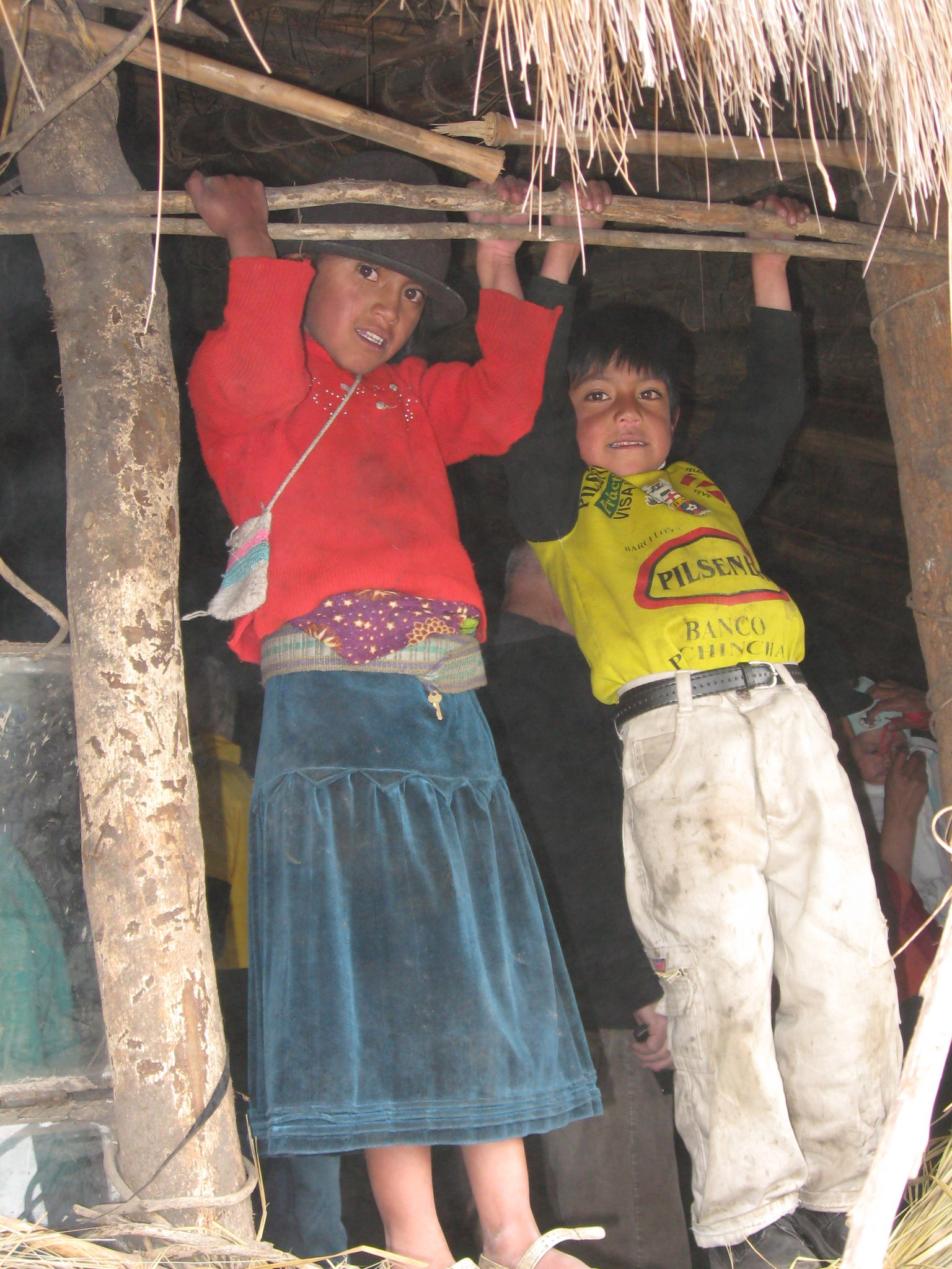 children-hanging-on-second-story-farmhouse.jpg