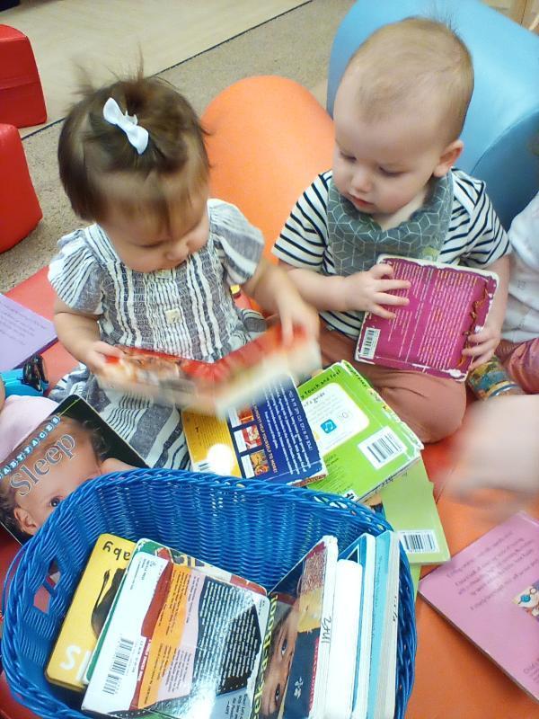 Infants reading books