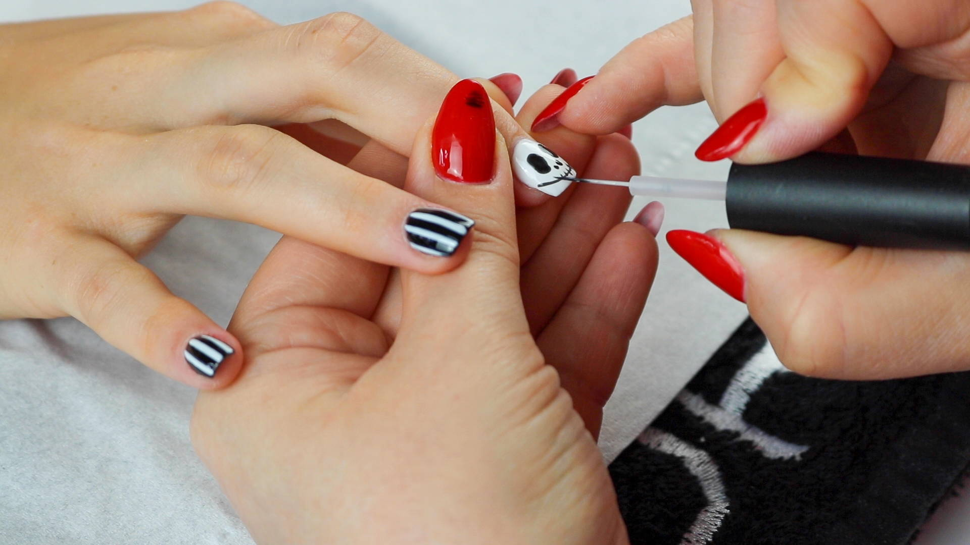 Jack Skellington nails mouth detailing being added to nails using ORLY Liquid Vinyl