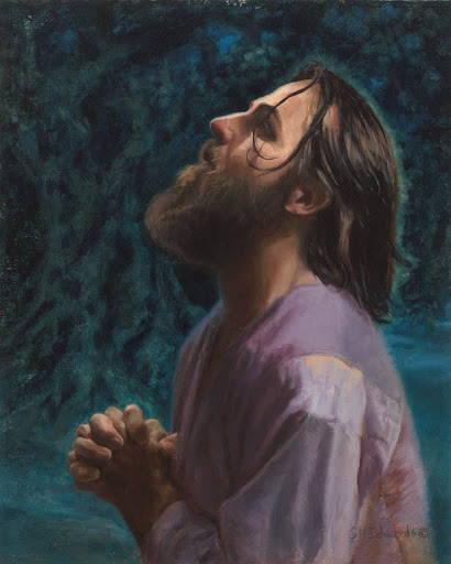 Vertical Jesus praying image. He kneels in the Garden of Gethsemane.