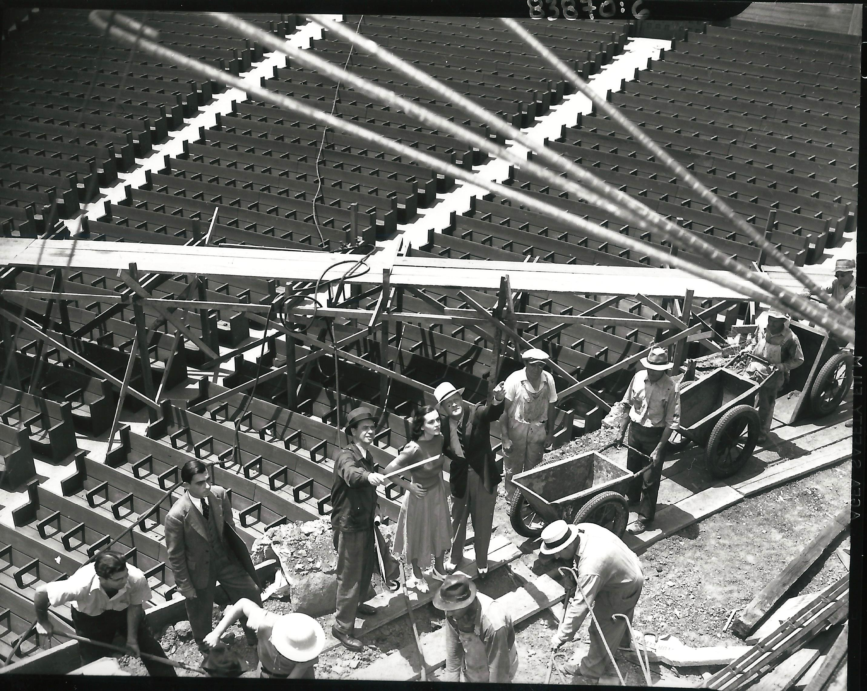 Remisoff (on the left, with pointer) oversees construction on stage right. <br> Photo courtesy of Otto Rothschild Collection, The Music Center