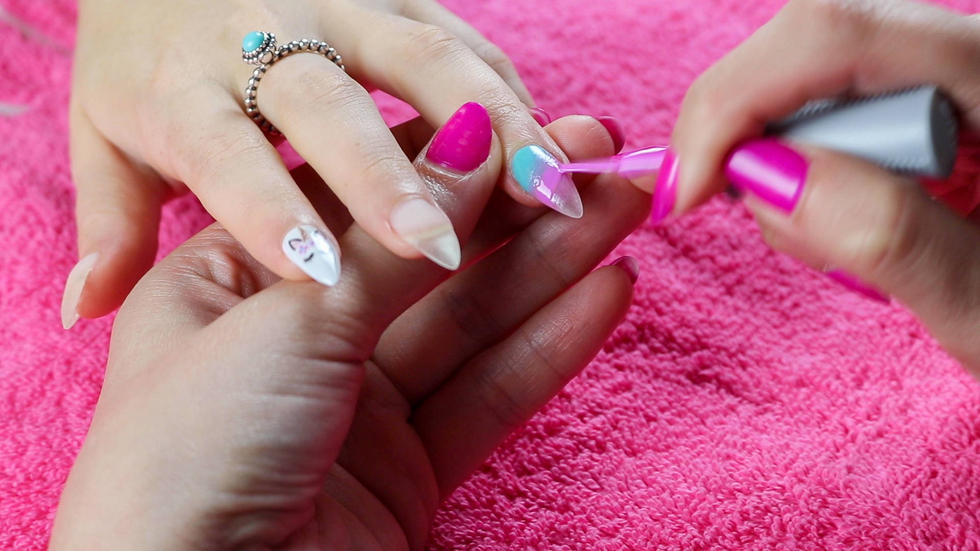 Unicorn nail art detail being sponged onto a nail to create a unicorn ombre nail design