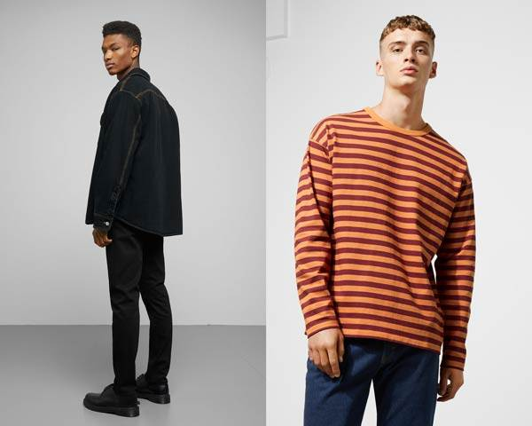 Man wearing organic cotton denim jacket with black denim trousers and derby shoes and man wearing orange and burgundy striped oversized long sleeve t-shirt with blue indigo jeans from sustainable fashion brand Weekday
