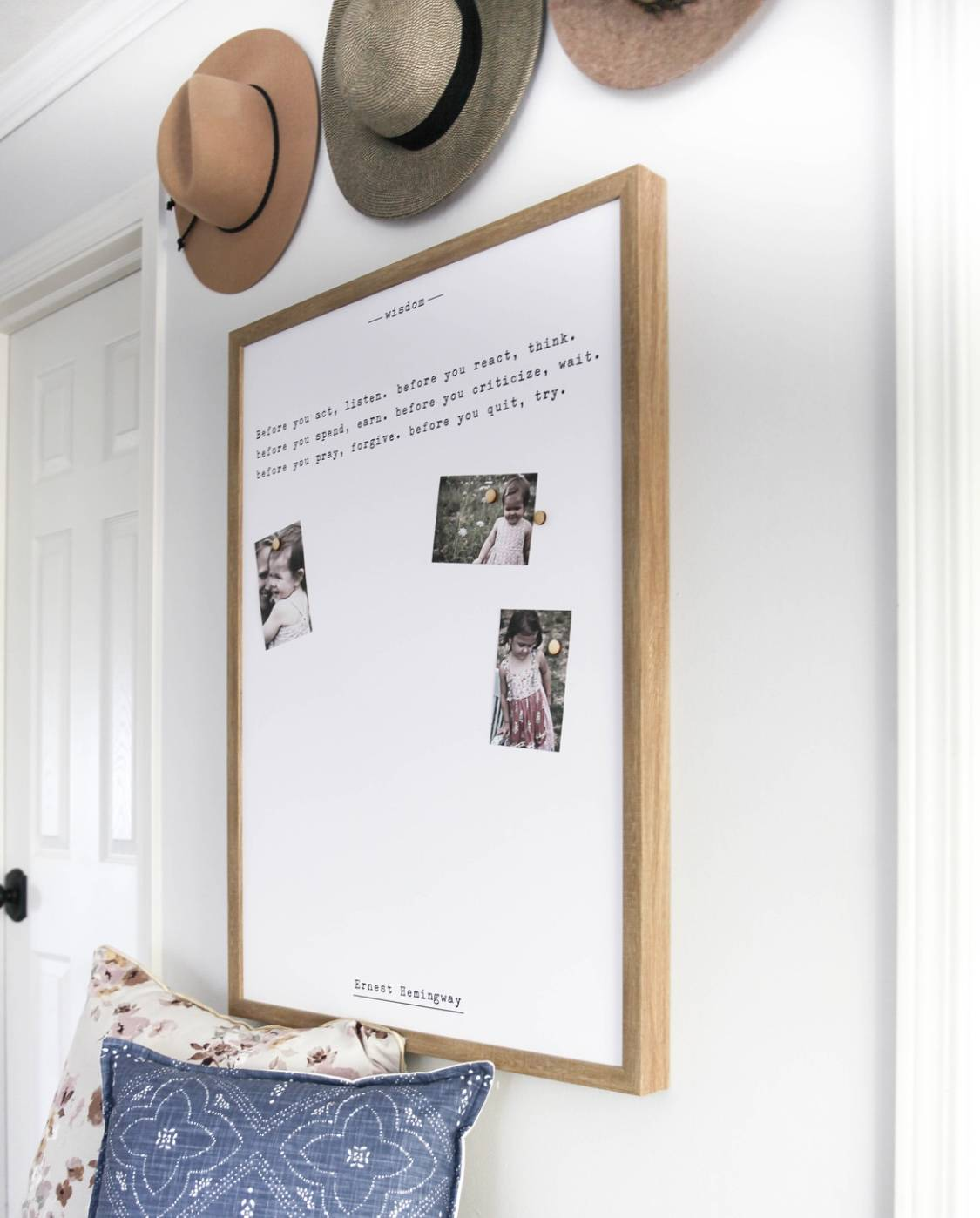 magnet board with pictures hanging on the wall