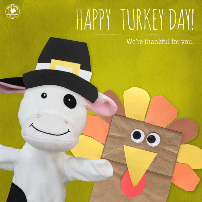 Happy turkey day poster featuring  the Primrose cow hand puppet and a DIY paper bag turkey