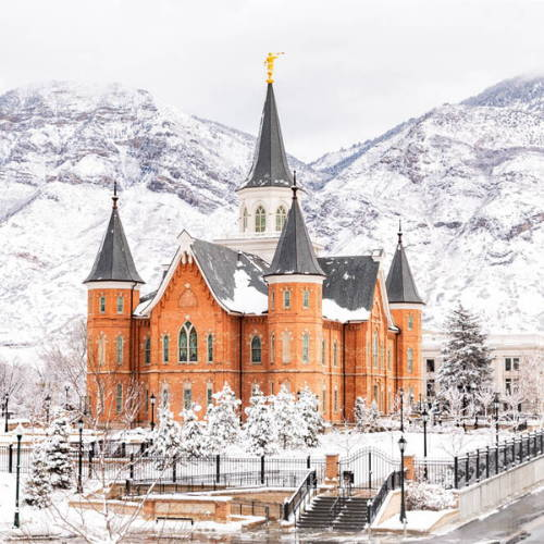 Photo of the Provo City Center Temple surrounded by snowfall and mountains.