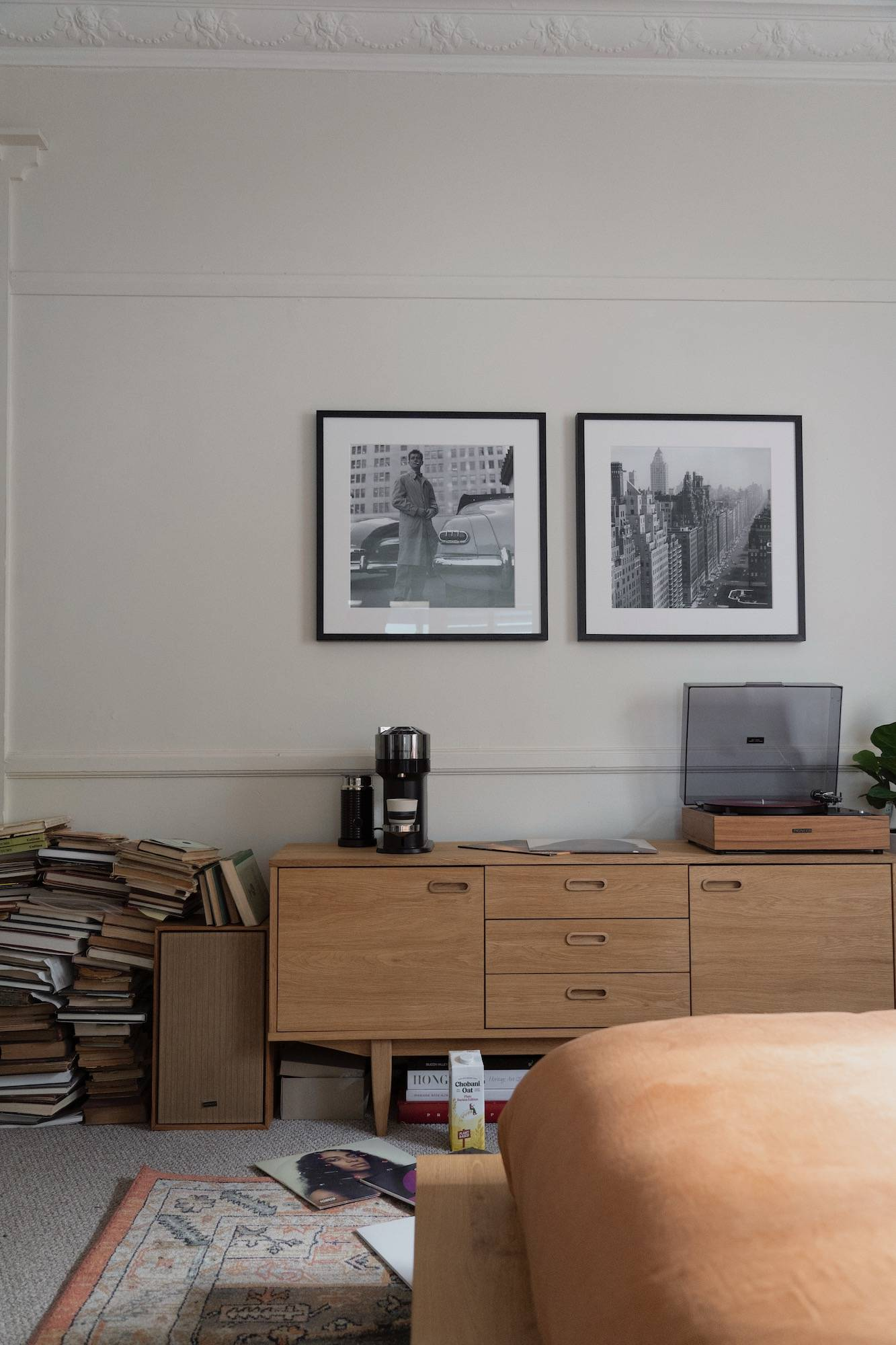 Black and white vintage Slim Aarons prints framed on the wall in the home of Jordan Turner.