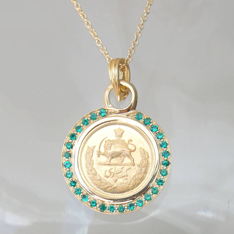 gold coin with emeralds pendant