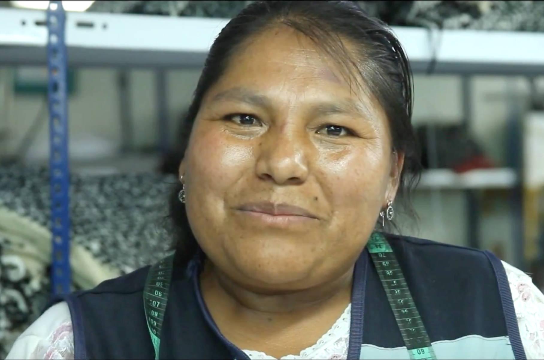 Smiling face detail of textile artisan woman in Peru