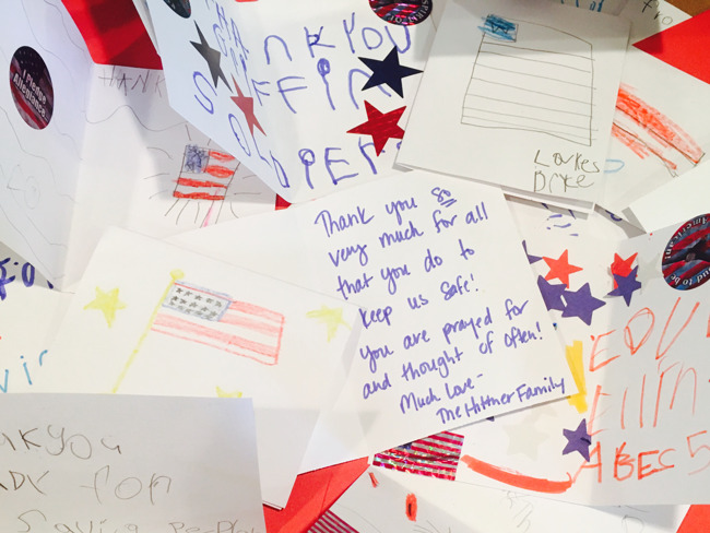 A pile of cards handwritten by students thanking the American troops for their service
