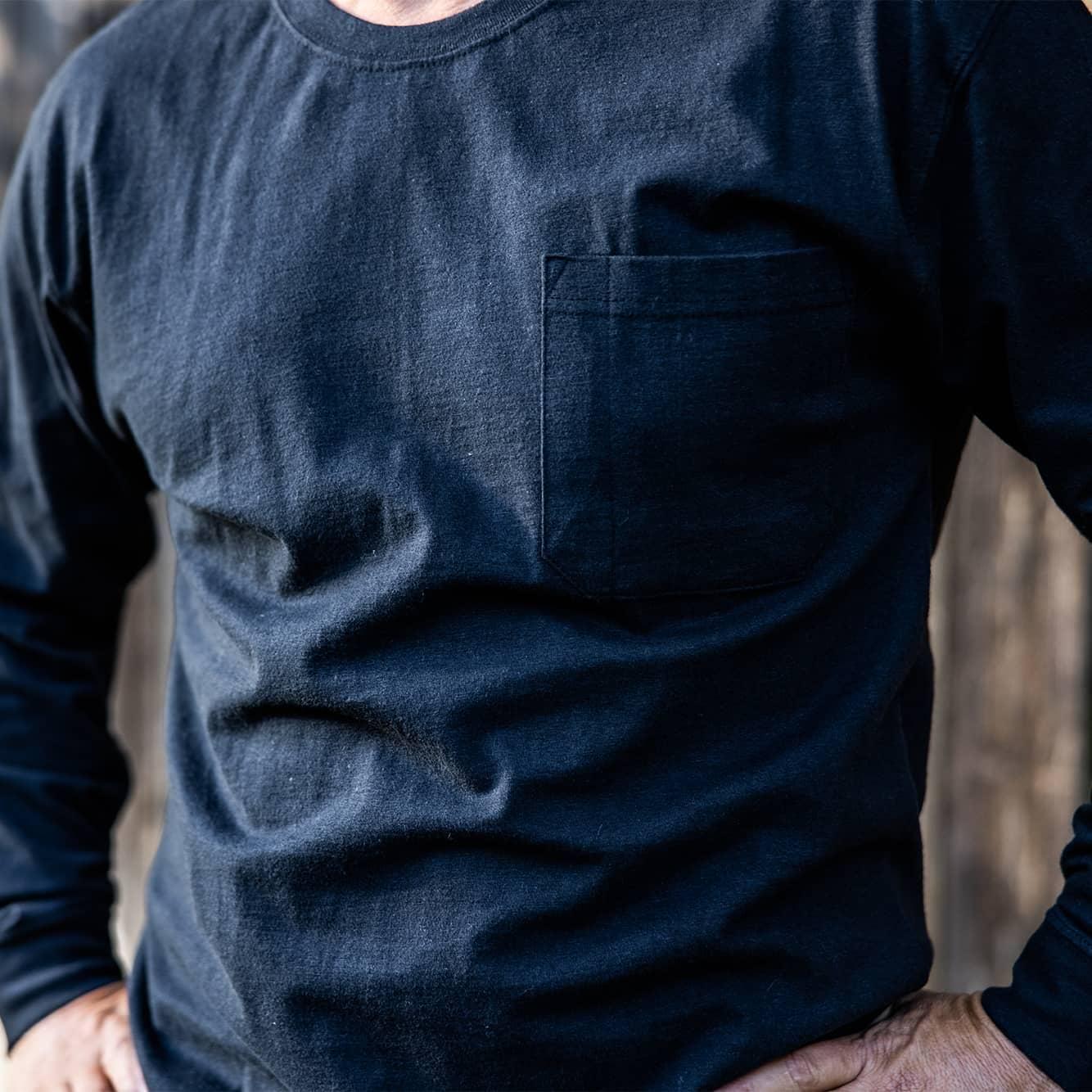 Man wearing long sleeve shirt outside