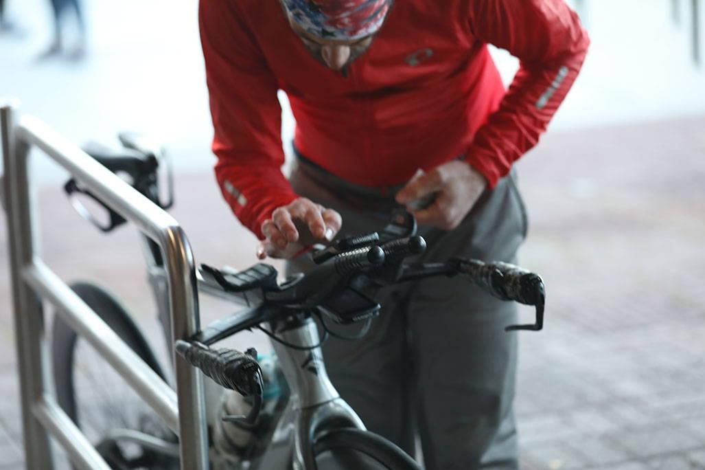 James grabbing bike handles