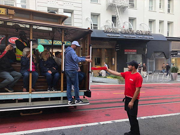 Giving samples to trolley riders as they go by