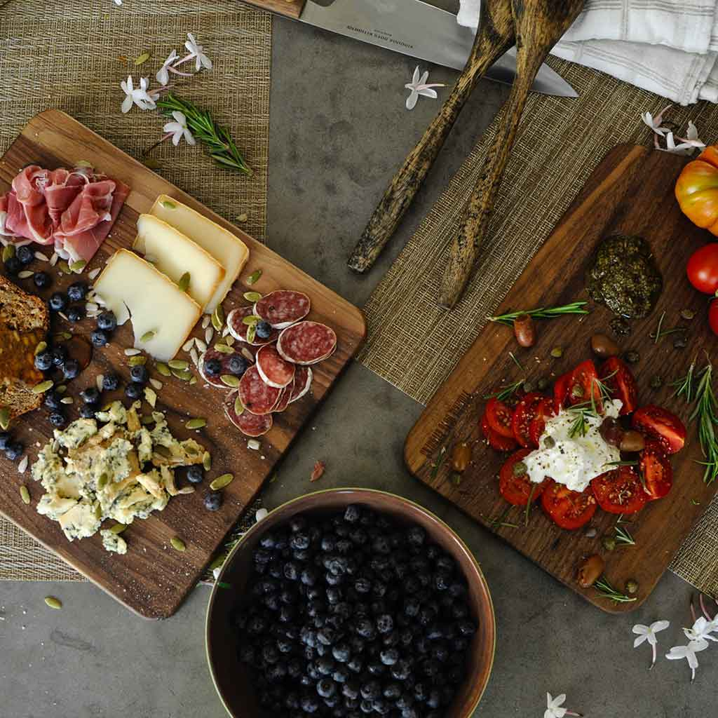 Pretty presentations of meats, cheeses, nuts, pizza, sushi, vegetables and anything else you can imagine