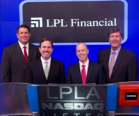 John Hyland [third from left] has long had his destiny tied with LPL. This photo was taken in 2011 at Nasdaq bell ringing.