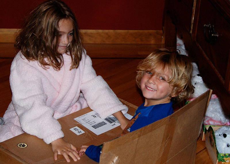 kids playing in cardboard box