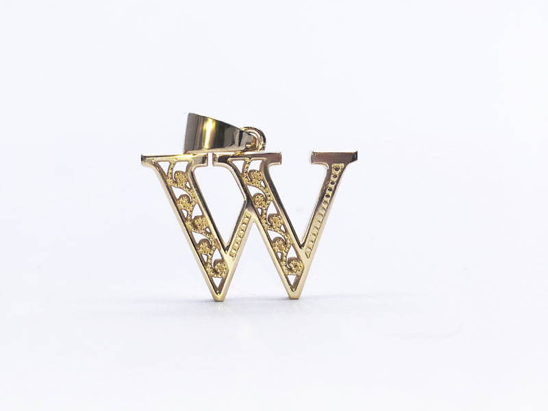 Yellow gold pendant representing the letter W with filigree motifs